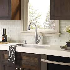 white glass tile backsplash white countertop with dark white backsplash with white cabinets