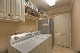 image of small basement laundry room light fixtures