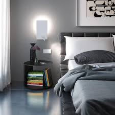 above bed lighting. Trendy Recessed Bedroom Wall Sconce Light Above Minimalist End Table And Tufted Black Leather Head Board Bed Lighting R