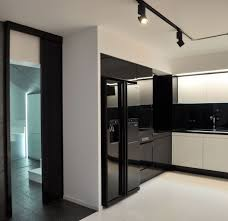 modern warehouse apartment interior design with track lighting and gloss kitchen storage black track lighting