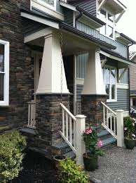 chain downspout. Cute Home Exterior Decoration Using Dark Brown Stone Front Porch Pillar Including Copper Rain Chain Gutters And Small White Wood Handrails Downspout L