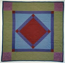 1900 - 1925 Amish  Hanging Diamond  Quilt | National Museum of ... & ... in the early twentieth century, this is a beautiful example of Amish  quilting utilizing a traditional pattern. The dark red 25½-inch center  diamond with ... Adamdwight.com