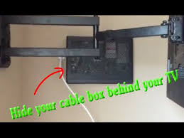 hide cable verizon box behind tv on