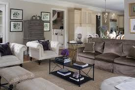 brown sofa with white accent chairs