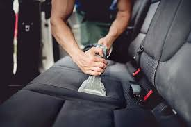 close up details of car detailing cleaning and vacuuming car interior