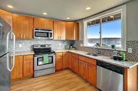 honey oak cabinets with black galaxy granite kitchen countertops