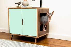 Image Ideas These Midcentury Modern Inspired Cabinets Hide Cats Litterbox Contemporist These Midcentury Modern Inspired Cabinets Hide Cats Litterbox