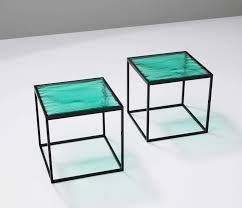 multiple green coloured glass side tables with metal box frame
