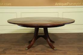 59 74 round mahogany dining table with leaves