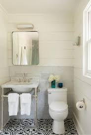 cottage bathroom with black and white cement quatrefoil tile floor