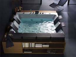this stunning indoor jacuzzi the thais art whirlpool tub measures 7 feet by 7 5 feet square and comfortably sits 4 with it s anthracite colored cushions