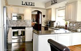 oak kitchen remodel and update with painted cream cabinets dark wood flooring quartz countertop