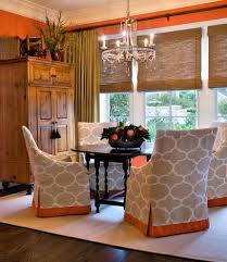 lorraine vale inspiration for a timeless dining room remodel in charleston with orange walls bedroomendearing small dining tables