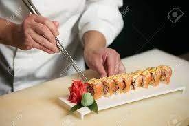 Sushi Cook Male Chef Cooks Preparing Sushi In The Restaurant Kitchen Chef