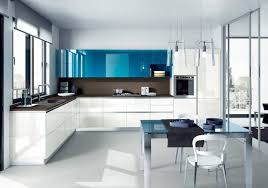 Black and white kitchen with turquoise blue upper cabinets