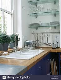 Modern Kitchen Shelving Double White Sink Below Window In Modern Kitchen With Glass
