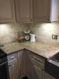new traventine back splash giallo ornamental granite complement white mushroom cabinets giallo santo classic15 classic