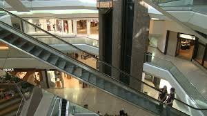 people on escalators. escalators ascending with people while elevator descends within mall (1 of 2) stock video footage - videoblocks on p