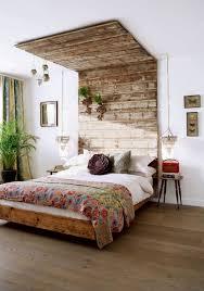 crystal chandelier between unique wooden headboard and tropical platform bed bedding set