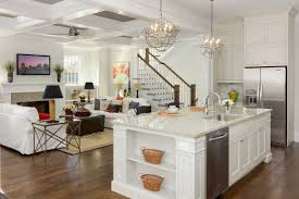 two mini silver steel cilcular kitchen cage chandelier over white wooden island placed on brown hardwood