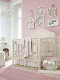Pink Nursery Room With Silver Corner Ottoman Also White Fur Rug And  Feminine Tender Colors And Gallery Baby Photo Frame And Crystal Chandelier  And Wall ...