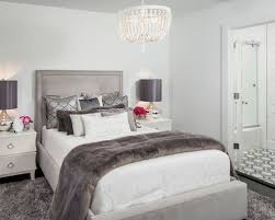 Inspiration for a contemporary master black floor bedroom remodel in  Orlando with white walls