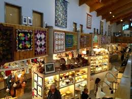 art quilts hanging above the very large and diverse gift shop ... & Southern Highland Craft Guild Folk Art Center: art quilts hanging above the  very large and Adamdwight.com