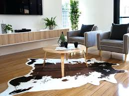 image of cowhide rugs area faux rug fake for attractive in home moving cowhide rug faux