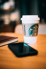 starbucks photography. Beautiful Photography Black Smartphone Beside A White Starbucks Cup Throughout Photography T