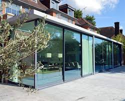 Full width glass extension with retractable doors creates a truly inside /  outside experience