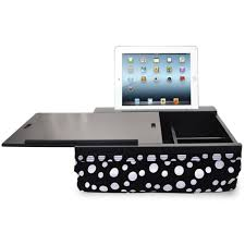 this lap desk can be used in the car bed chair or even on the floor while it s larger than most lap desks that s because the top slides open and allows