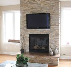 stacked stone fireplace wall with tv just needs a mantle