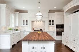 Off white kitchens Antique White White Kitchen Island With Wood Countertop Kemper Cabinets 30 Elegant White Kitchen Design Ideas For Modern Home