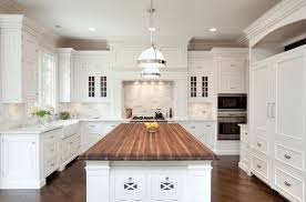 white kitchen island with wood countertop
