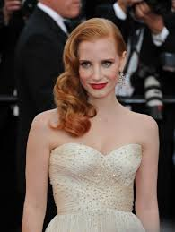 jessica chastain looked like an old hollywood ethereal dess at her recent appearance at the cannes film festival her clically bold makeup look and