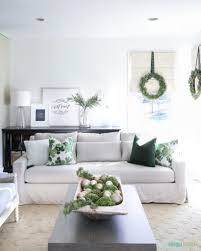 Christmas living with a linen York Slope Arm Sofa from Pottery Barn. I love  the