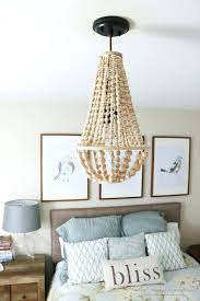 wood bead chandelier this wood bead chandelier is simple to make and costs so much less wood bead chandelier