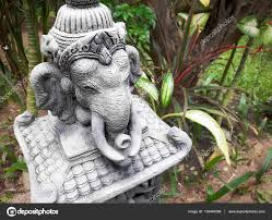 stone statue of elephant in the garden thailand stock photo