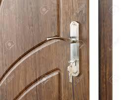 open door handle door lock with keys brown wooden door closeup isolated modern