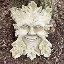 stone smiling wiccan pagan greenman