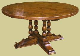 oak round dining table with carved base