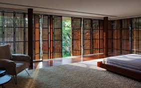A free first floor with large sliding glass doors which support a wooden box delimited by concrete&nbsp. Aeccafe Casa Toblerone In Sao Paulo Brazil By Studio Mk27