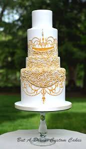 White Wedding Cake With Sugar Gold Pearls Deer Pearl Flowers