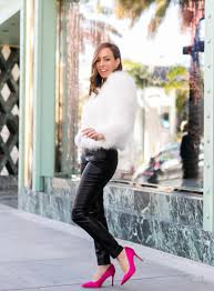 sydne style shows holiday cocktail party outfit ideas in feather jacket and leather pants