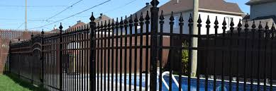 wrought iron fence gate. Black Wrought Iron Fence Around A Residential Area. Gate
