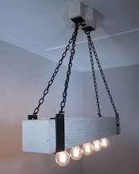 weathered white stain on wood beam chandelier