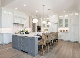 White Kitchen With Grey Island And White Oak Hardwood Floor With