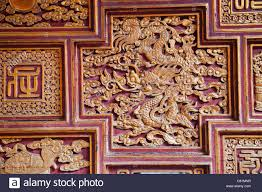 vietnam hanoi temple of literature wood carving panel depicting dragon on vietnamese wood carving wall art with vietnam hanoi temple of literature wood carving panel depicting