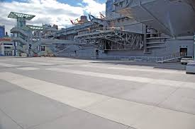 after pitted concrete plaza in front of the intrepid sea air and space museum in new york city gets a face lift with oldcastle s prospec concrete