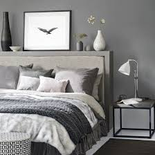 this dark grey bedroom with cosy bed linen create a relaxing space in which to unwind at the end of day layer soft furnishings luxurious walls d5 grey